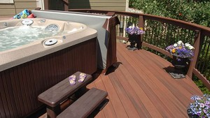 Even on a small deck, there must be enough room around the hot tub for the cover lift to function and air to circulate. On a larger deck, consider traffic flow around the space.